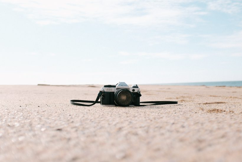 Camera on desert soil with sky in the background