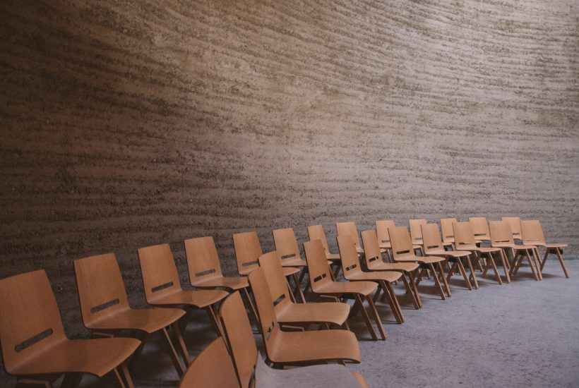 Two rows of wooden chairs