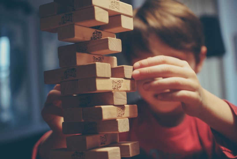 A kid playing jenga